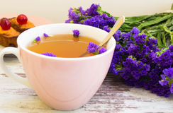 Herb tea with wildflowers Royalty Free Stock Image