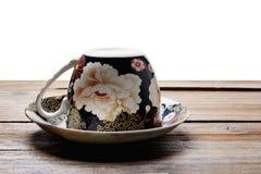 Herbaciana filiżanka i spodeczek obraz royalty free