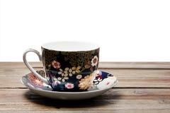 Herbaciana filiżanka i spodeczek obrazy stock