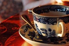 Herbaciana filiżanka i cukrowa łyżka Obraz Royalty Free