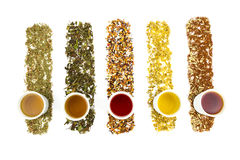 Herbaciane filiżanki z różnorodnymi kolorowymi herbatami Zdjęcia Royalty Free