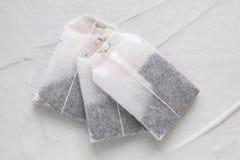 Herbaciane torby na lekkim tle Fotografia Stock