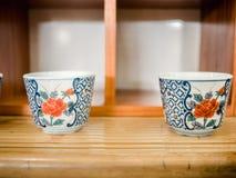 2 herbacianej filiżanki na bambusa stole obraz royalty free
