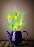 Herbaciany garnek z liśćmi i kolorowymi abstrakcjonistycznymi światłami Zdjęcie Stock