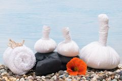Herbal bags and towels with stones for massage royalty free stock photos