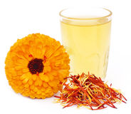 Herbal calendula flower with extract in a glass Stock Photo