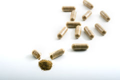 Herbal capsules. Alternative herbal capsules isolated on white Royalty Free Stock Photo