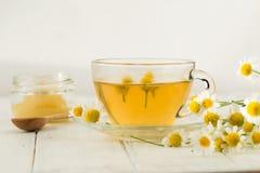 Herbal chamomile tea isolated on white background. NHerbal chamomile tea isolated on white backgroundn stock photo