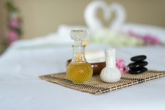 Herbal compress ball,Oil and set spa objects on wood textile bac Royalty Free Stock Photography