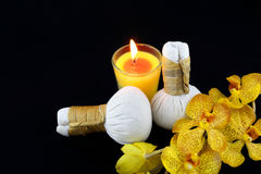 Herbal compress balls with candle Royalty Free Stock Images