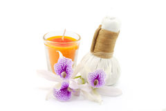 Herbal compress with candles Stock Images