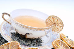 Herbal cup of tea with leaves and lemons Stock Photos