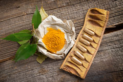Herbal curcumin capsules Stock Photos
