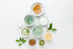 Herbal dermatology cosmetic hygienic cream for beauty and skincare product. honey, lemon, almond, kiwi, cucumber, aloe vera, salt. Yogurt on white background royalty free stock image