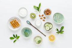 Herbal dermatology cosmetic hygienic cream for beauty and skincare product. honey, lemon, almond, kiwi, cucumber, aloe vera, salt. Yogurt on white background stock image