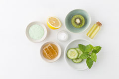 Herbal dermatology cosmetic hygienic cream for beauty and skincare product. honey, lemon, kiwi, cucumber, salt, mint, oil on whit. E background stock image