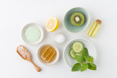 Herbal dermatology cosmetic hygienic cream for beauty and skincare product. honey, lemon, kiwi, cucumber, salt, mint, oil on whit. E background royalty free stock photography