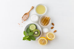 Herbal dermatology cosmetic hygienic cream for beauty and skincare product. honey, lemon, kiwi, cucumber, salt, mint, oil on whit. E background stock photo