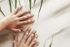 Adult and children`s hygienic manicure. Herbal design on short nails.Striped manicure of nature.Nail art.Adult and children`s hygienic manicure stock image