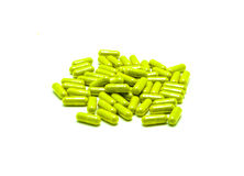 Herbal Drug . and alternative medicine in capsule. Green Herbal Drug . and alternative medicine in capsule Royalty Free Stock Photography