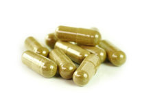 Herbal drugs capsules isolated on white Royalty Free Stock Images