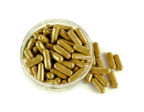 Herbal drugs capsules isolated on white Royalty Free Stock Image
