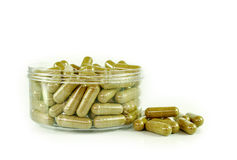 Herbal drugs capsules isolated on white. Stock Photography