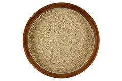 Herbal facial scrub in light brown color in a wooden bowl isolat Royalty Free Stock Photo