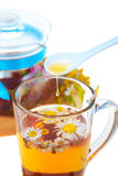 Herbal floral tea with drop of honey Royalty Free Stock Images