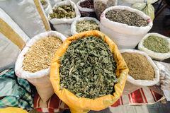 Herbal health treatment cure plants, daisy, linden, mint, oregano, thyme in sale at open air bazaar, market.  Royalty Free Stock Images