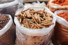 Herbal health treatment cure plants, spices cinnamon stick daisy at open air bazaar, market.  Royalty Free Stock Images