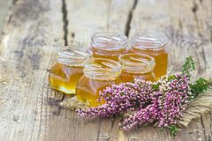 Herbal honey with heather flowers royalty free stock photos