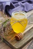 Herbal honey in jar Royalty Free Stock Images