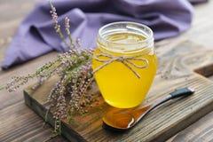 Herbal honey in jar Stock Images