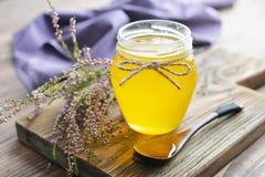Herbal honey in jar Royalty Free Stock Photo