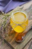 Herbal honey in jar Stock Photography