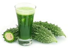 Herbal juice of green momodica Stock Image