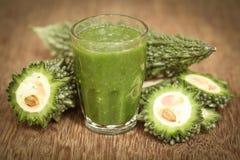 Herbal juice of green momodica Royalty Free Stock Image