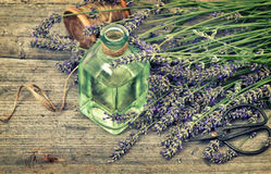 Herbal lavender oil with fresh flowers bouquet. Country style st Royalty Free Stock Photos