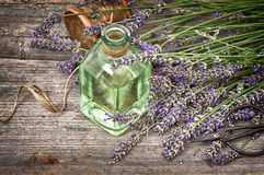 Herbal lavender oil with fresh flowers bouquet on wooden backgro Stock Image