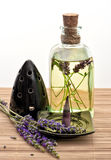 Herbal lavender oil with incense stick and fresh flowers Stock Photography