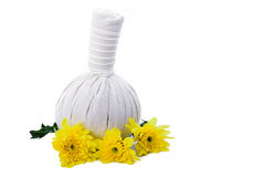 Herbal massage ball and yellow flowers Stock Photography