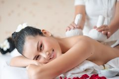 Herbal Massage in a spa.  royalty free stock photo