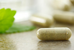 Herbal medicine in capsules. Close up of herbal medicine in capsules Stock Photo