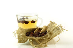 Herbal medicine. Cup of herbal tea with briar on a white background. Cup of herbal tea with dried rose hips in a sack Stock Photography