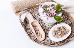 Herbal medicine pills over white Stock Photo
