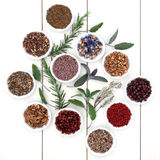 Herbal Medicine. Selection also used in witches magical potions over distressed white wood background Stock Photography