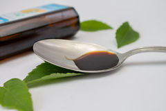 Herbal medicine in spoon Stock Photos