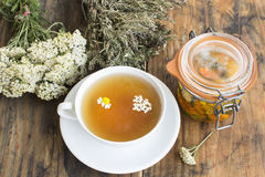 Herbal Medicine, Tea, Yarrow, Savory, Chamomile and Calendula Oi. L on a Rustic Wooden Background Royalty Free Stock Images