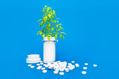 Herbal medicine - tree growing on pile of drugs Royalty Free Stock Photos